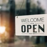 Welcome Sign on a Business - We're Open